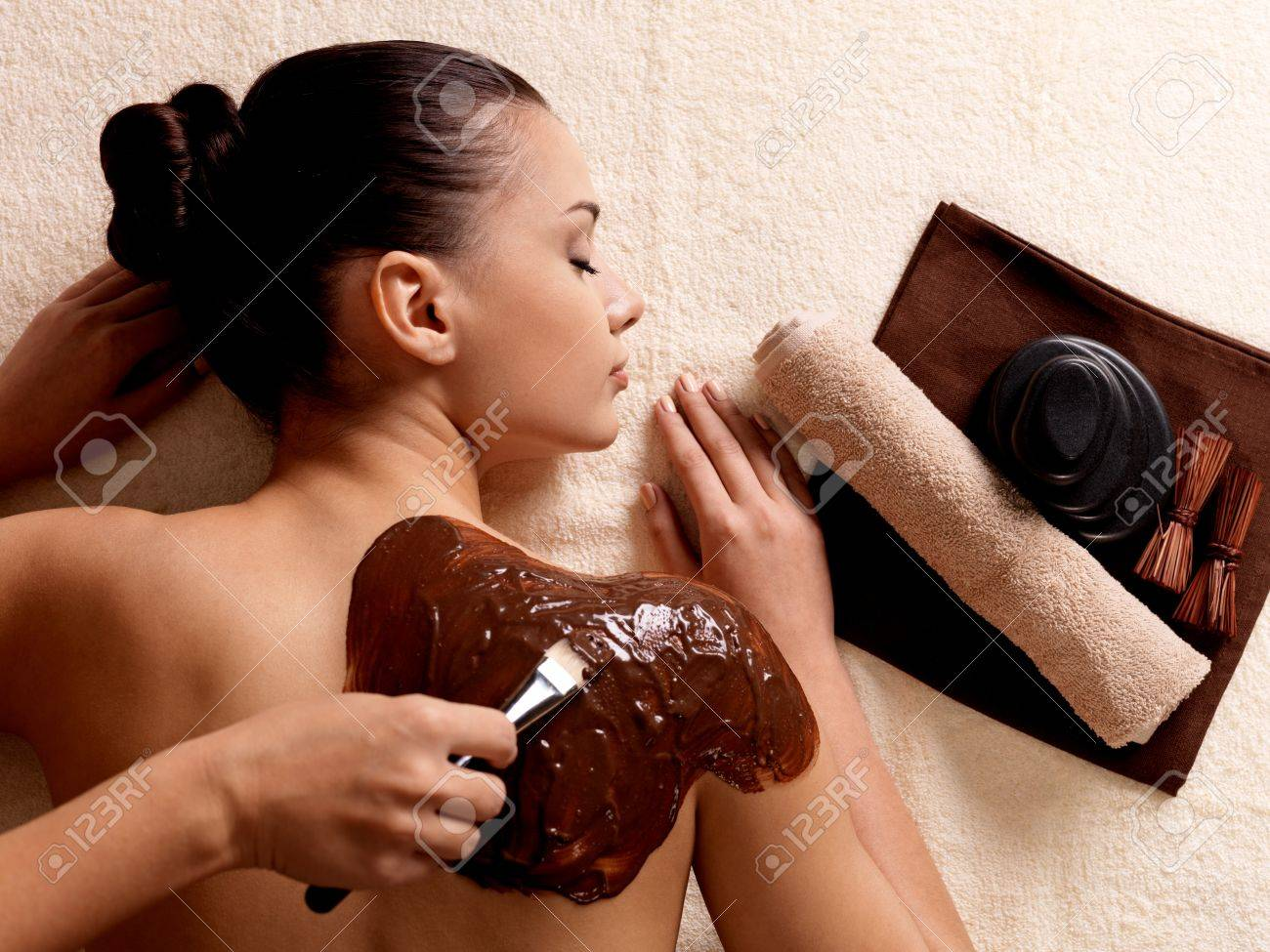 Spa therapy for young woman receiving cosmetic mask on back at beauty salon Stock Photo - 16578477