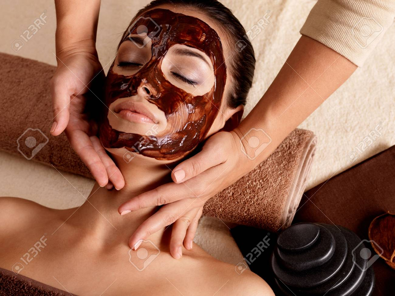 Spa massage for young woman with facial mask on face - indoors Stock Photo - 16578478