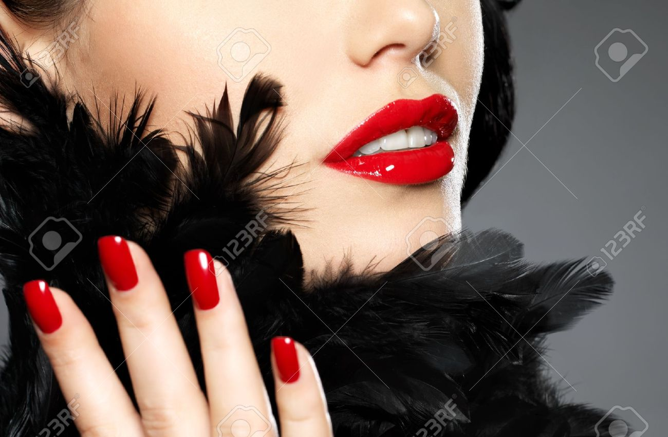 Macro photo of  woman with fashion red nails and sensual lips Stock Photo - 16642942