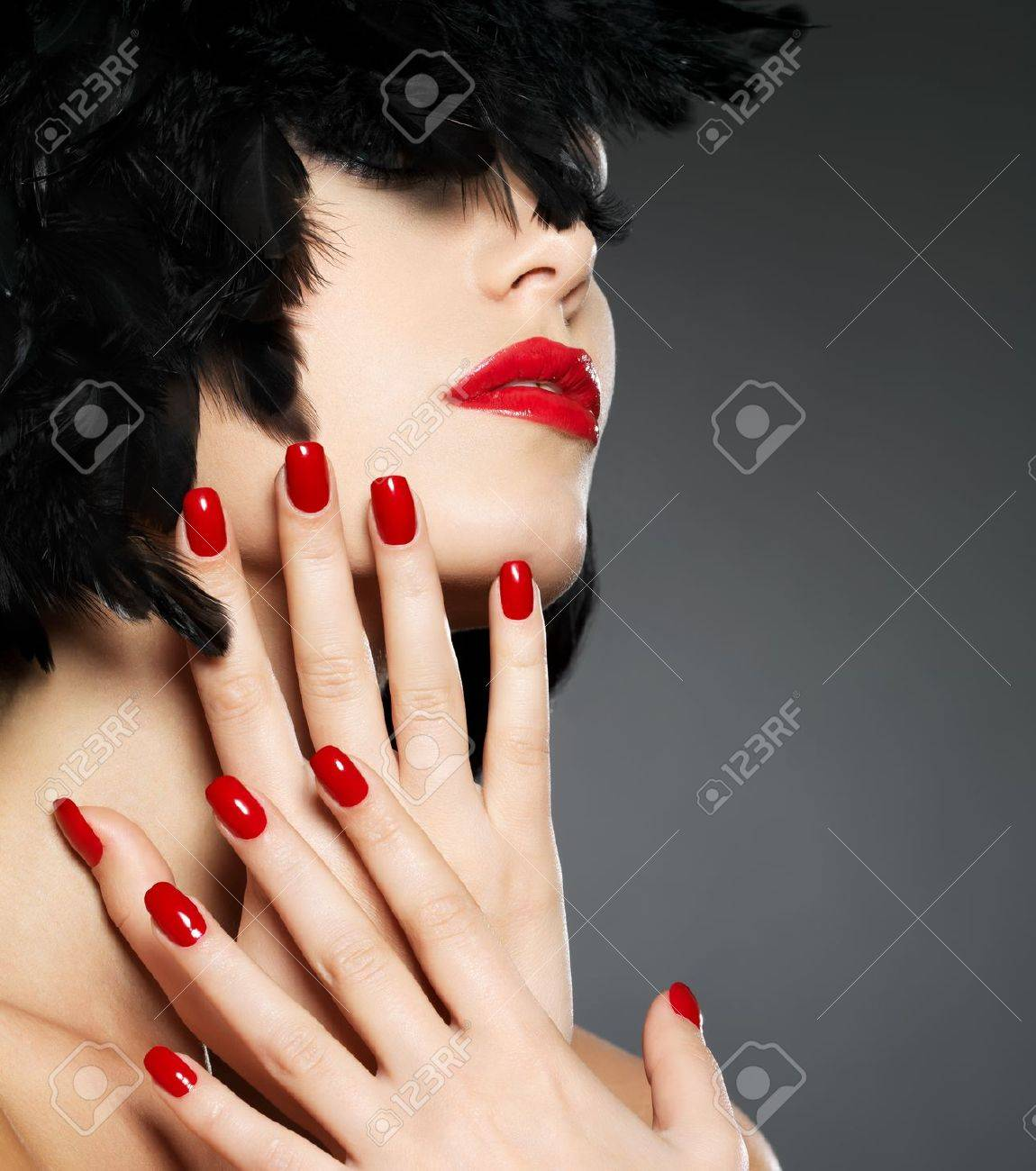Macro photo of  woman with fashion red nails and sensual lips Stock Photo - 16732159