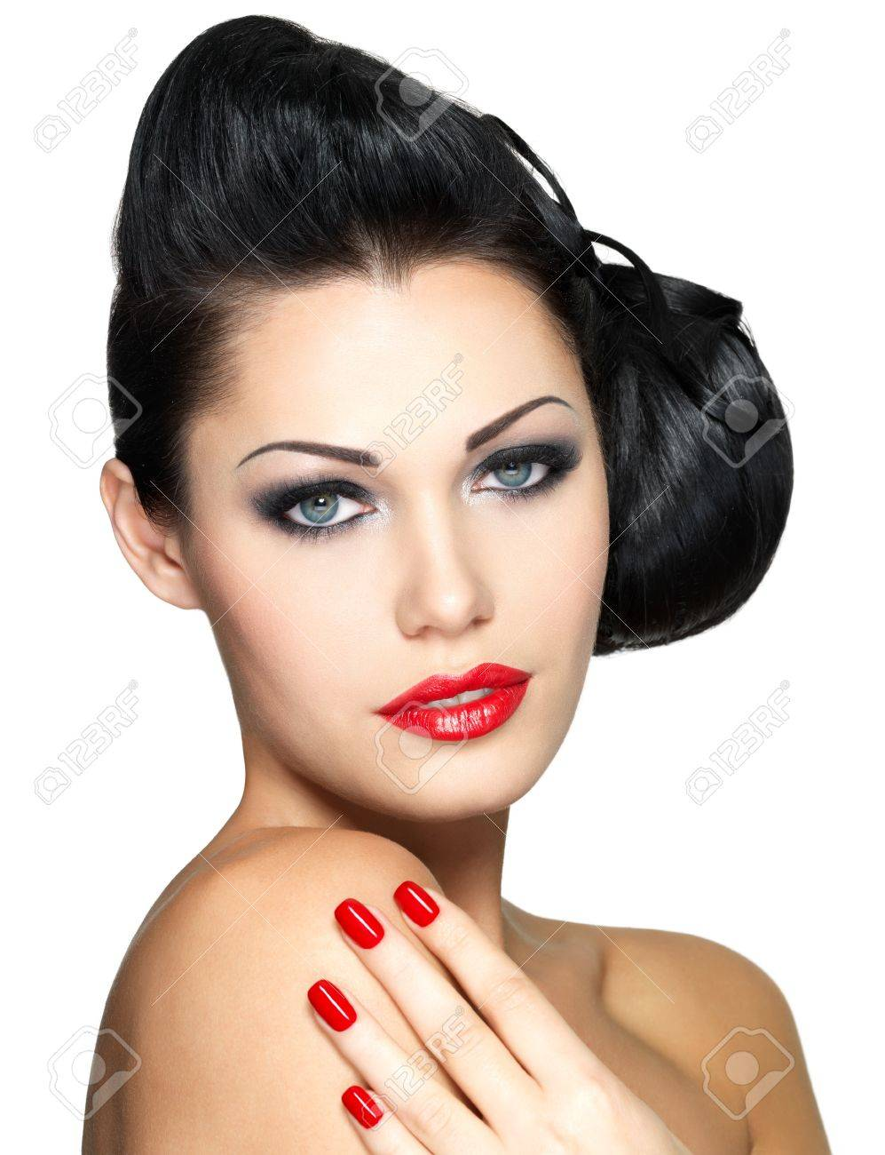 Beautiful young woman with red nails and fashion makeup - isolated on white background Stock Photo - 16642943