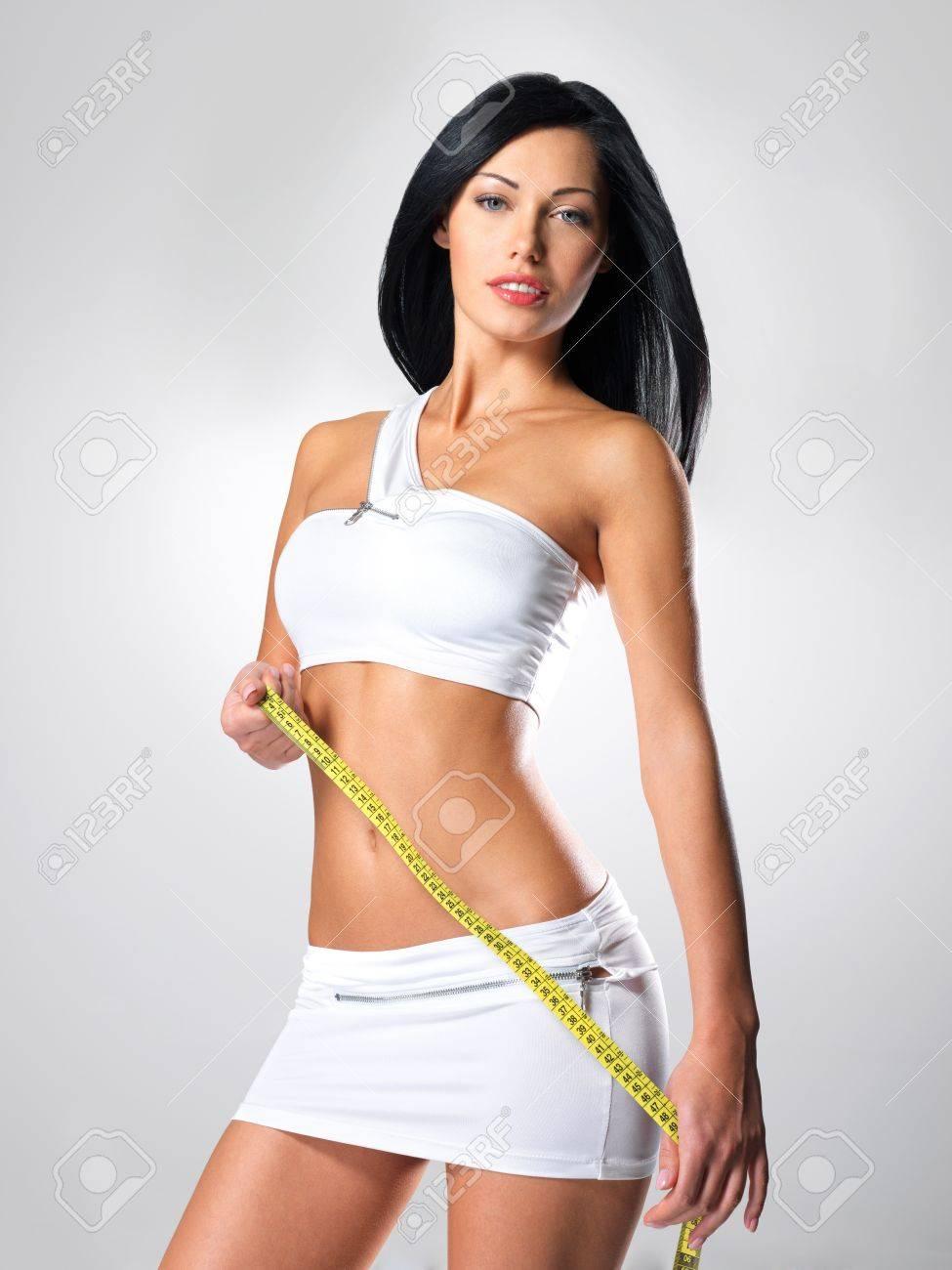 Sporty beautiful woman with measure tape - studio shot Stock Photo - 16642970