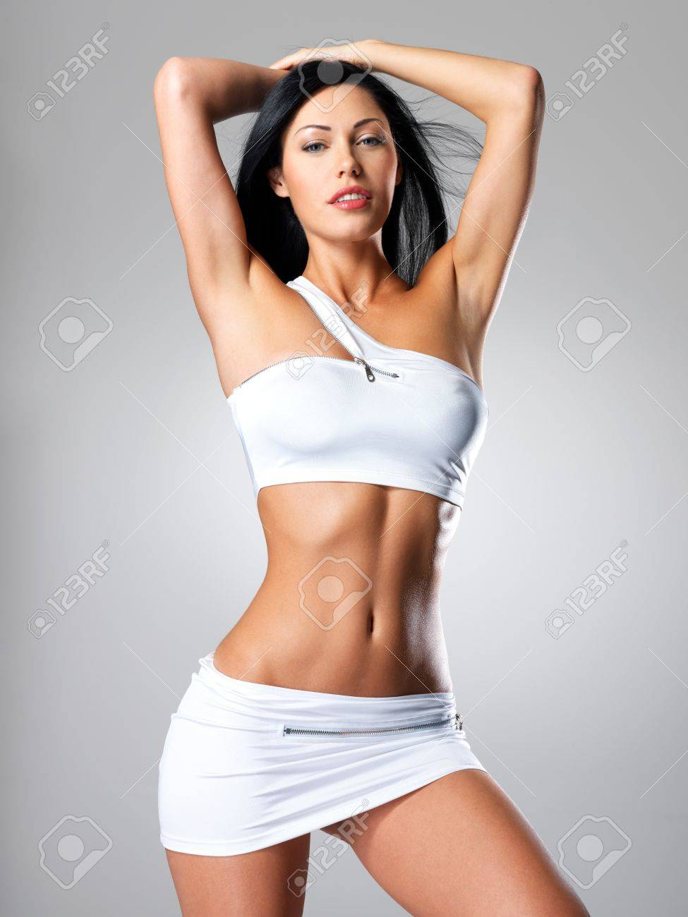 Pretty woman with perfect tanned body - a studio shot Stock Photo - 16642961