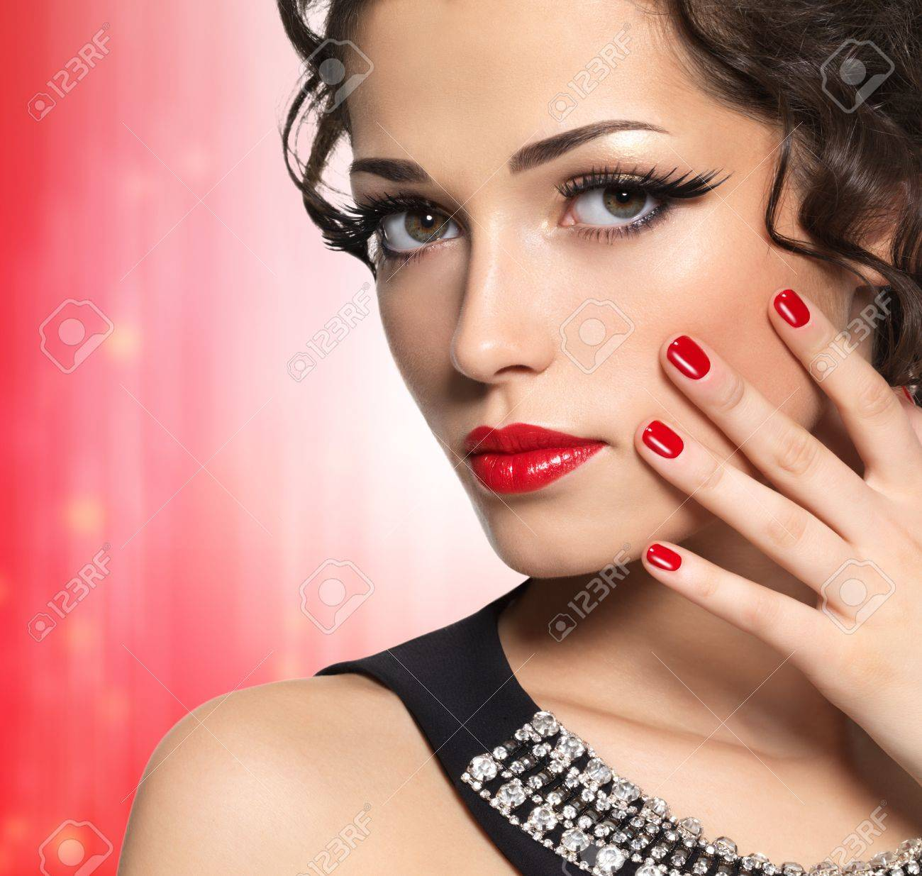 Beautiful  fashion model with red manicure and lips - isolated on white background Stock Photo - 17286941