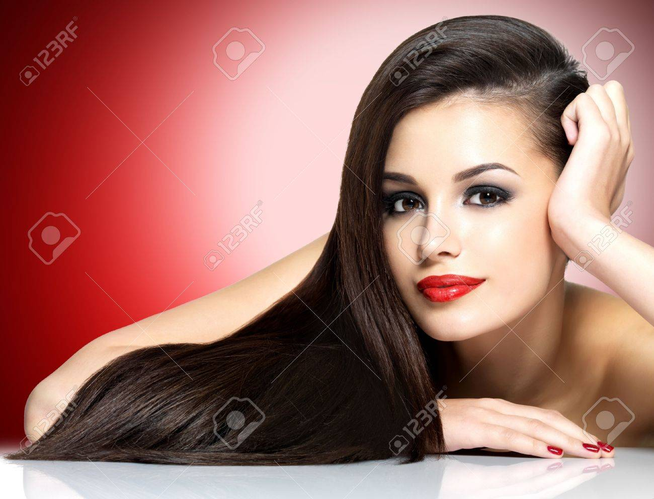Beautiful woman with long brown straight hairs - isolated on white background Stock Photo - 17286949