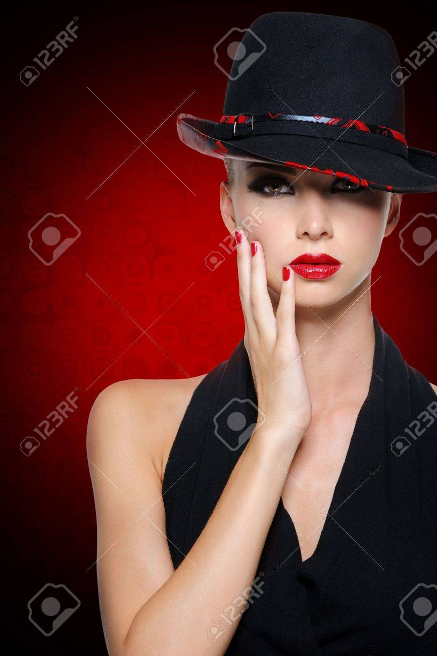 Beautiful glamour woman with bright sexy red lips dressed in black dress. Art background. Stock Photo - 17501657