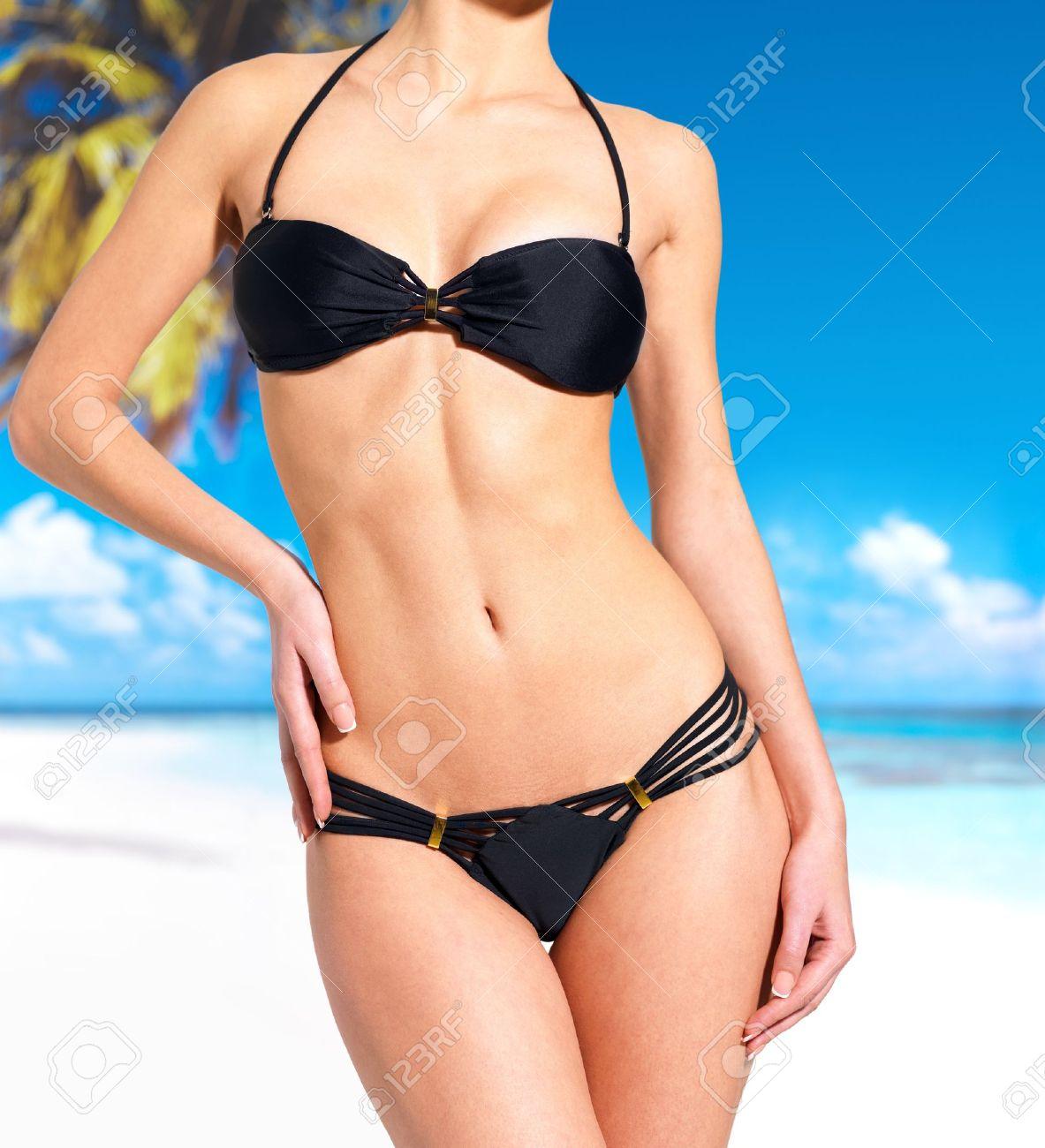 beautiful slim body of woman in bikini  at beach Stock Photo - 17450489