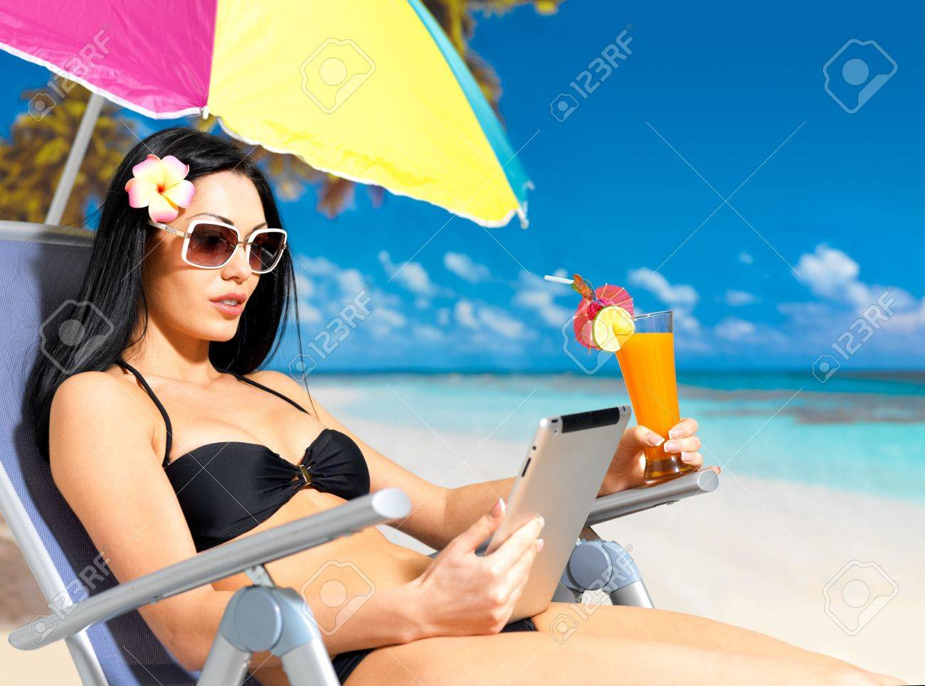 Beautiful woman on the beach with ipad. Vacation and communication concept. Stock Photo - 17447580