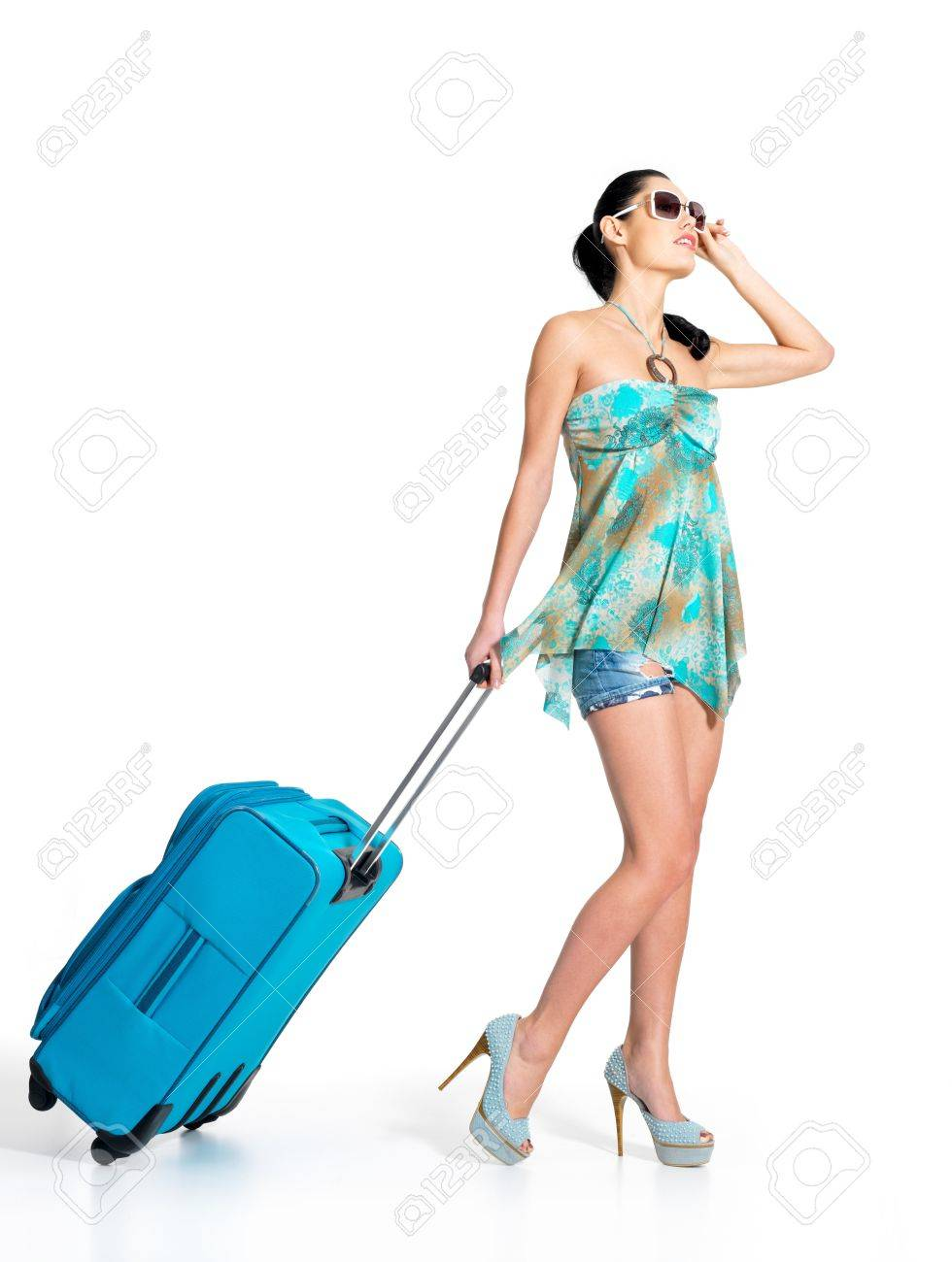 Full length of casual woman standing with travel suitcase - isolated on white background Stock Photo - 17447654