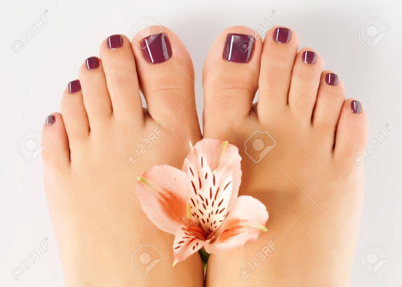 closeup photo of a female feet with beautiful pedicure after.. stock