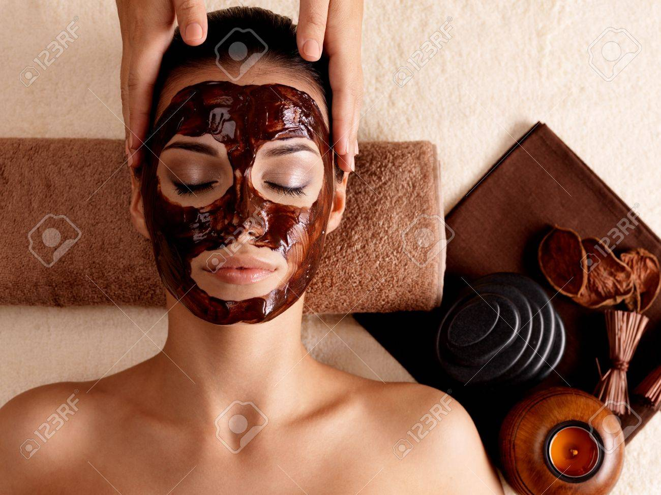 Spa massage for young woman with facial mask on face - indoors Stock Photo - 17642679
