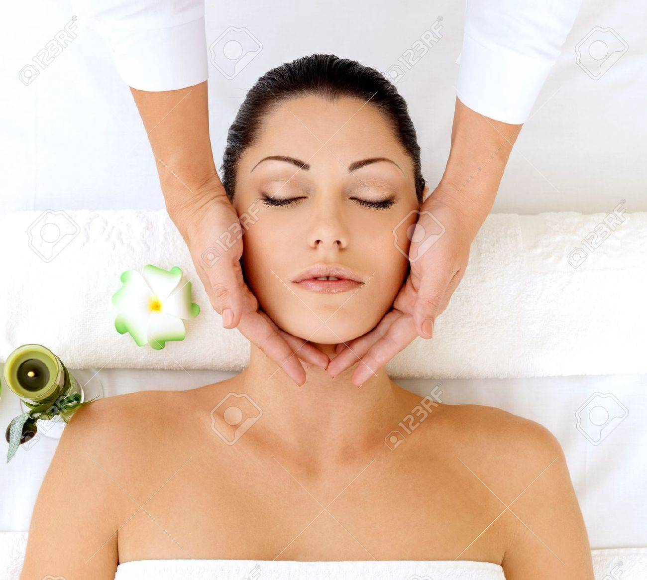 Woman having massage of head in the spa salon. Beauty treatment concept. Stock Photo - 17853349