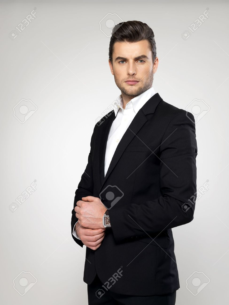 Fashion young businessman black suit casual  poses at studio Stock Photo - 17853427