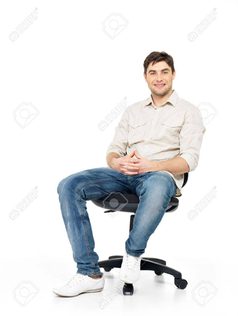 Portrait of smiling happy man sits on the office chair isolated on white. Stock Photo - 18352473