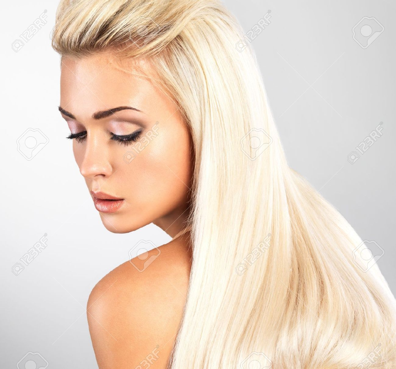 Beautiful woman with long straight blond hair. Fashion model posing at studio. Stock Photo - 18462498