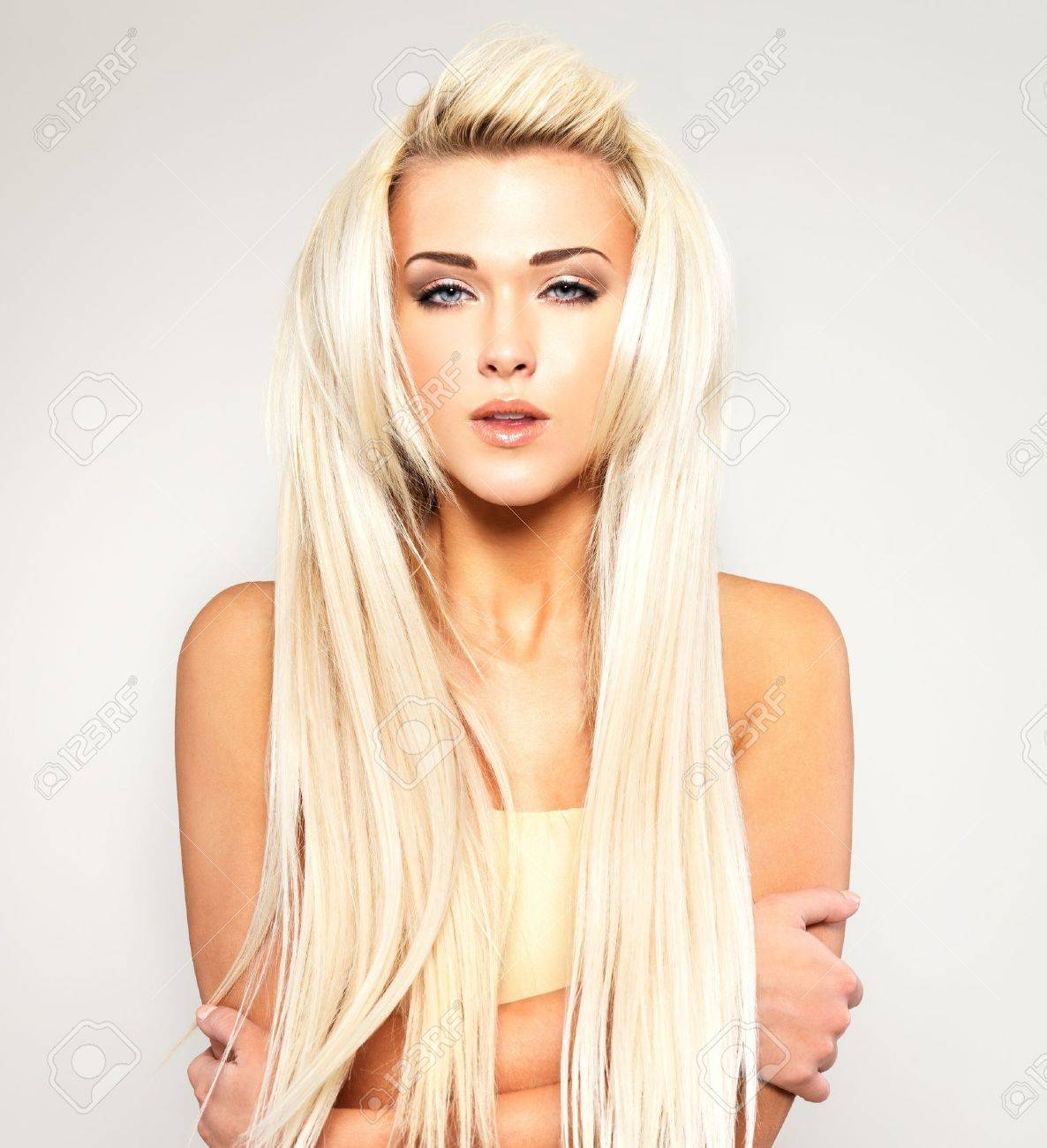 Beautiful woman with long straight blond hair. Fashion model posing at studio. Stock Photo - 18462497