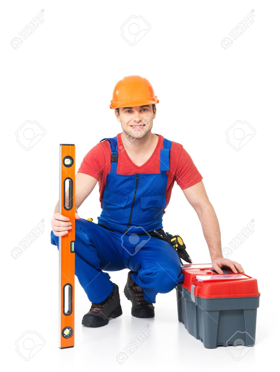 Portrait of smiling manual worker with tools isolated on  white background Stock Photo - 18629044