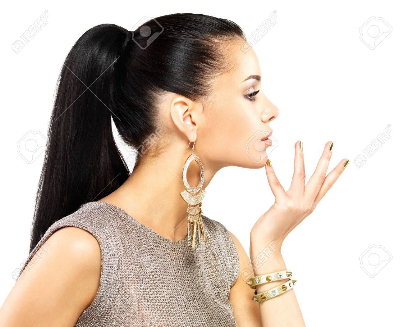 Pretty woman with golden nails and beautiful gold jewelry isolated on white background Stock Photo - 18629168