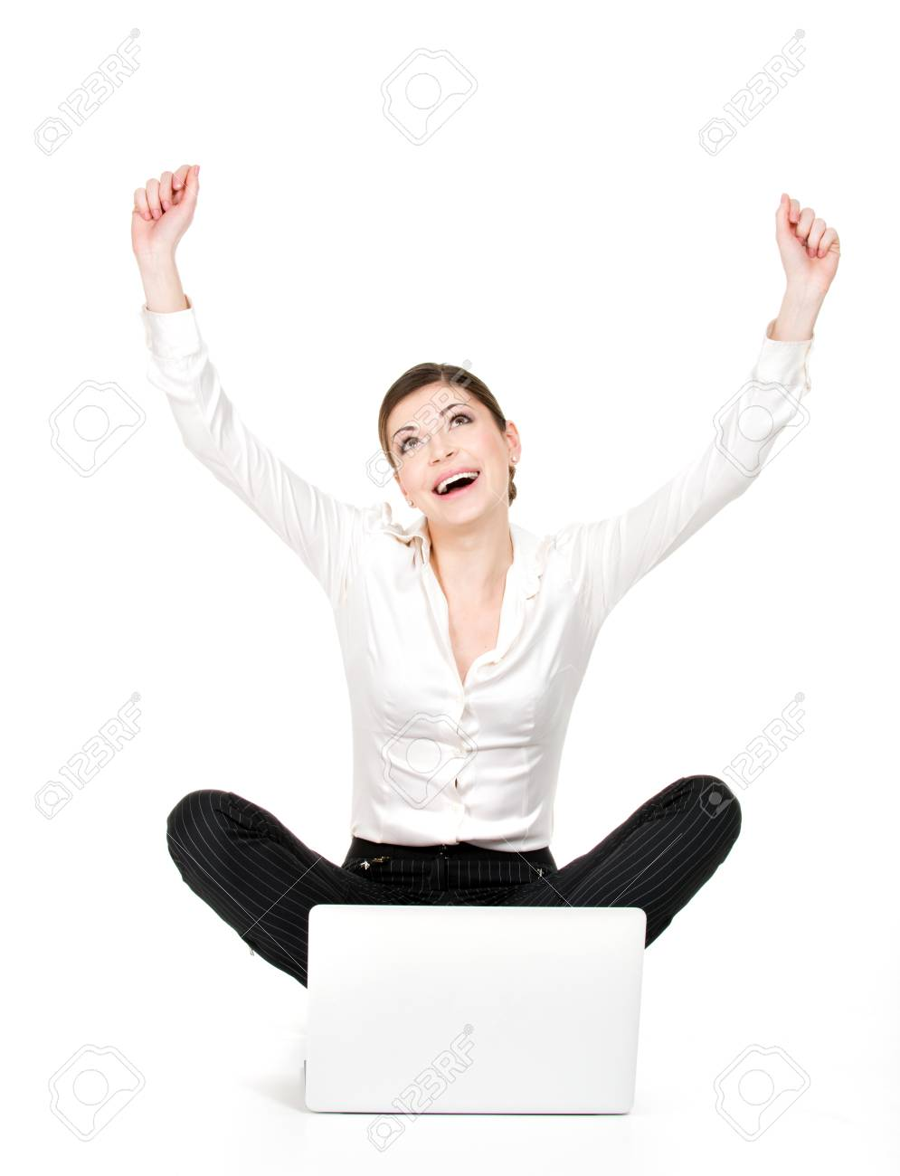 Successful business woman with laptop raised hands up - isolated on white. Stock Photo - 18824657