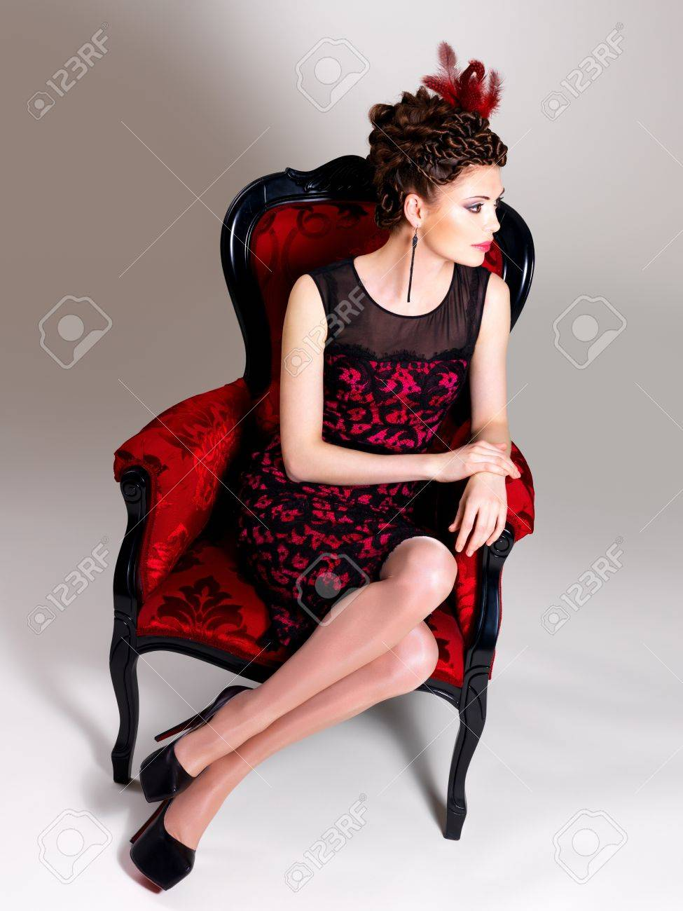 Beautiful Adult Woman With Fashion Hairstyle And Red Armchair