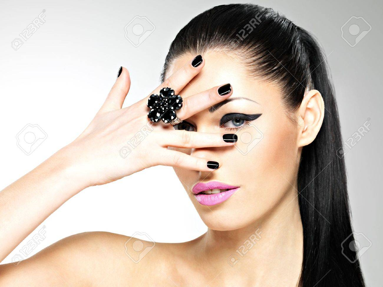 Face of the  beautiful sexy  woman with black nails and pink lips. Sexy girl with fashion makeup Stock Photo - 19270915