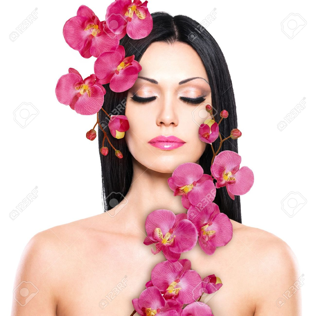 Young woman with beautiful face and fresh flowers skin care young woman with beautiful face and fresh flowers skin care concept stock photo dhlflorist Gallery
