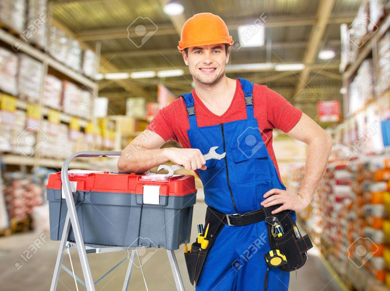 Portrait of smiling manual worker with tools at warehouse Stock Photo - 20364857