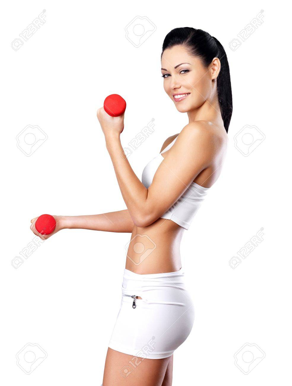 beautiful happy woman with dumbbells -  grey studio background. Healthy lifestyle concept. Stock Photo - 21886302