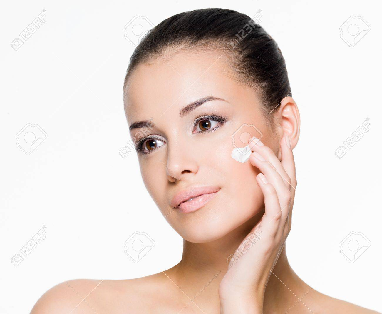 Portrait Of Beautiful Woman Applying Cream On Face - Isolated.. Stock  Photo, Picture And Royalty Free Image. Image 21886376.