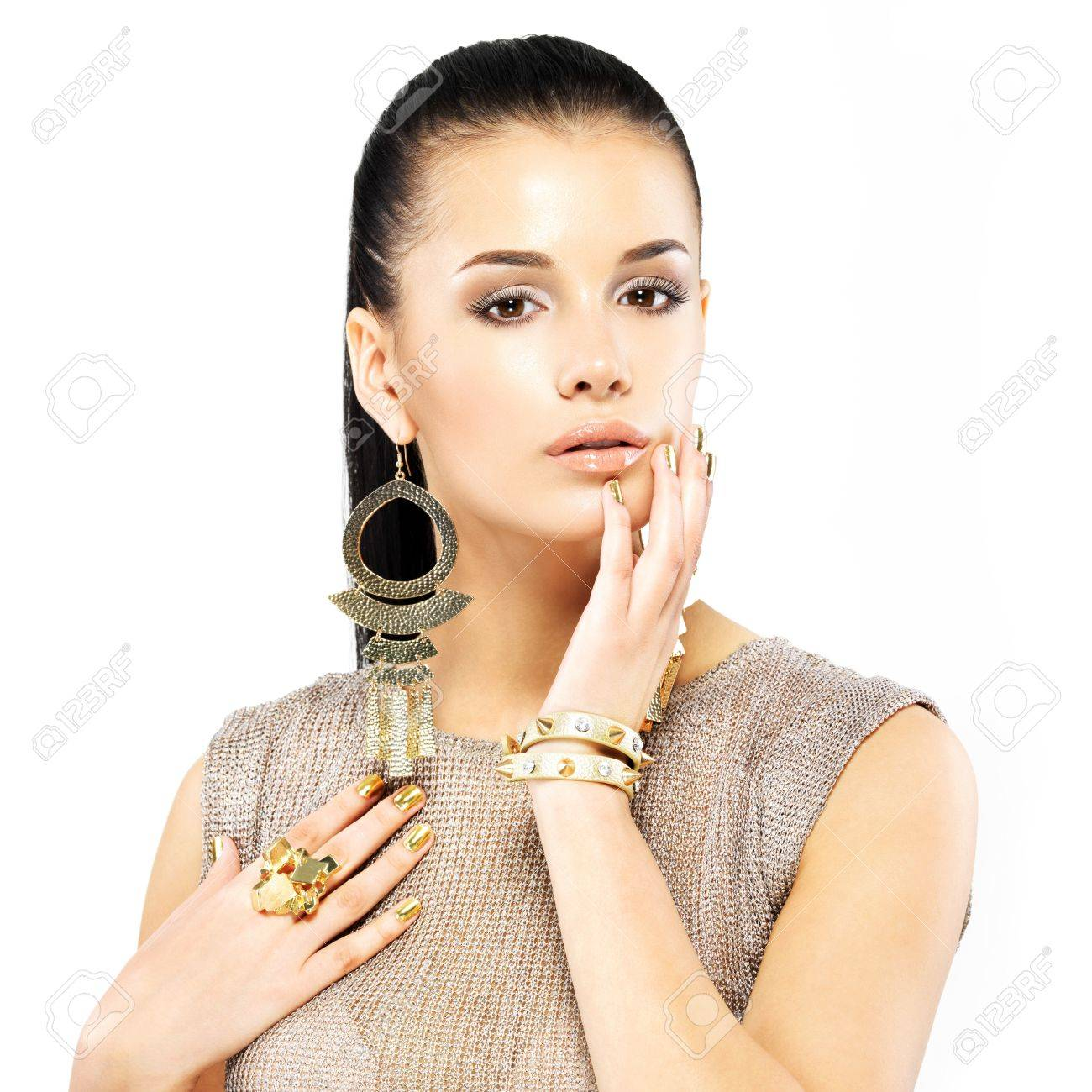 Pretty woman with golden nails and beautiful gold jewelry isolated on white background Stock Photo - 21886389