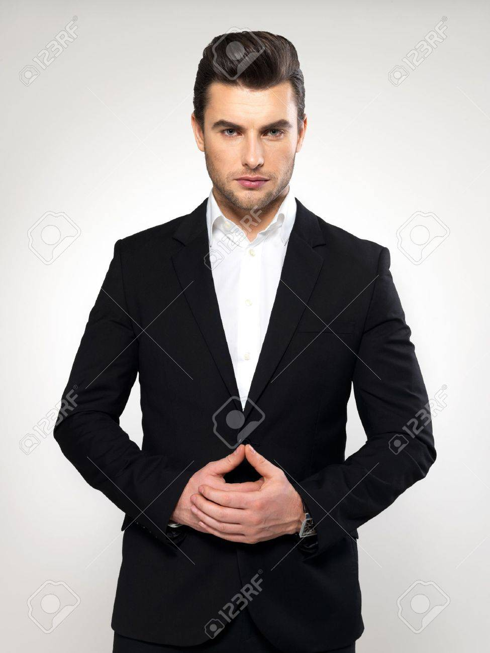 Fashion Young Businessman Black Suit Casual Poses At Studio Stock