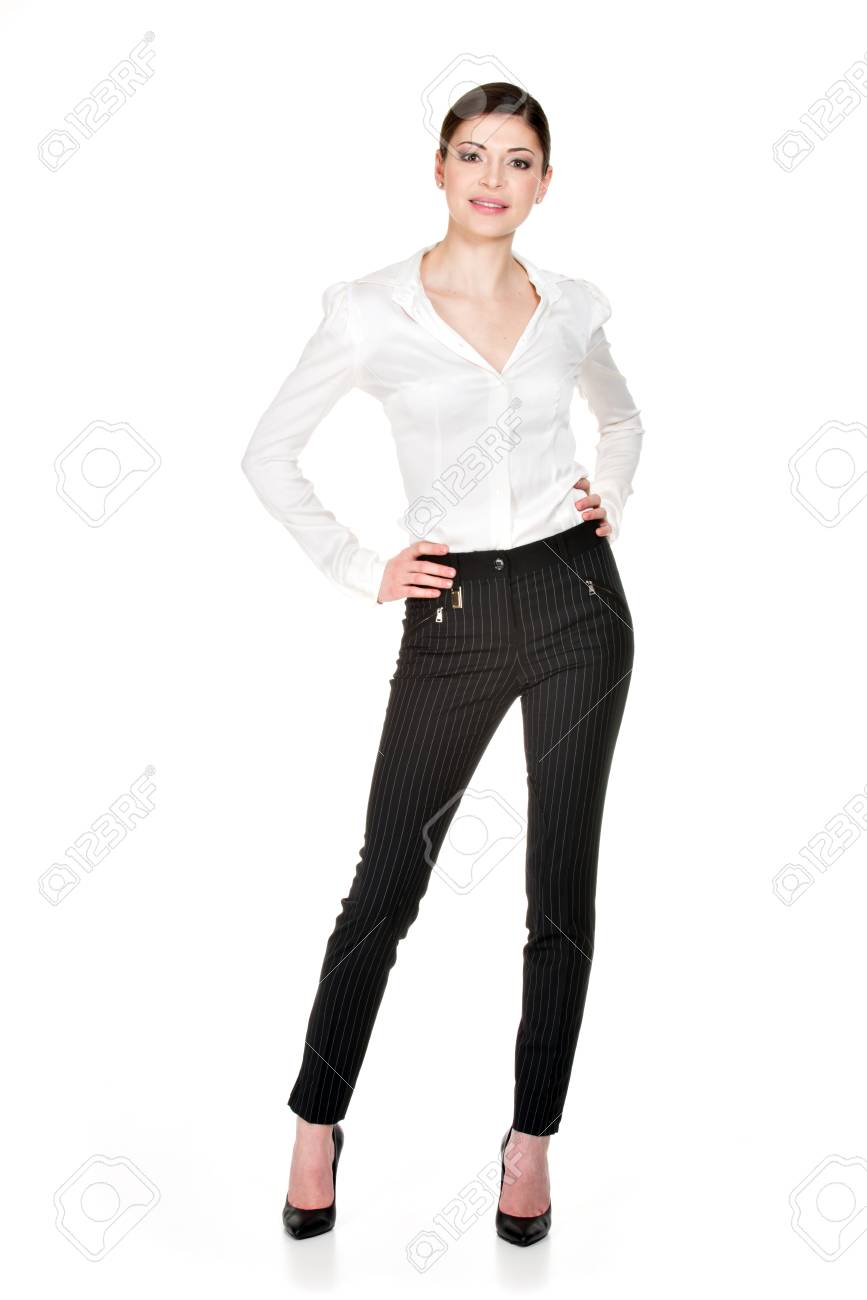 groothandel super populair 100% kwaliteit Volledige portret van jonge mooie vrouw in wit overhemd en zwarte broek  staan geïsoleerd op witte achtergrond.