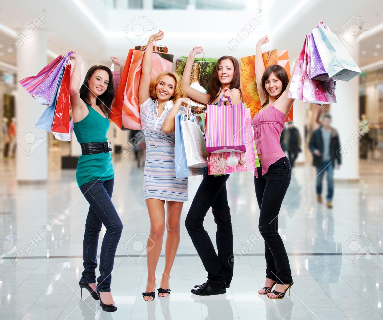 Happy Beautiful Women With Shopping Bags Stands At Shop Stock ...