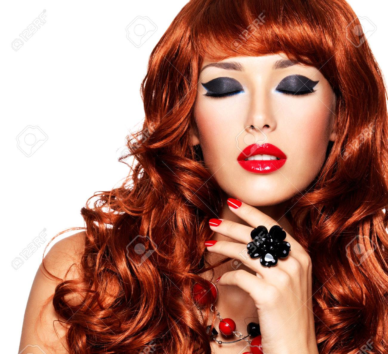 Beautiful Sensual Woman With Long Red Hairs And Red Nails With ...