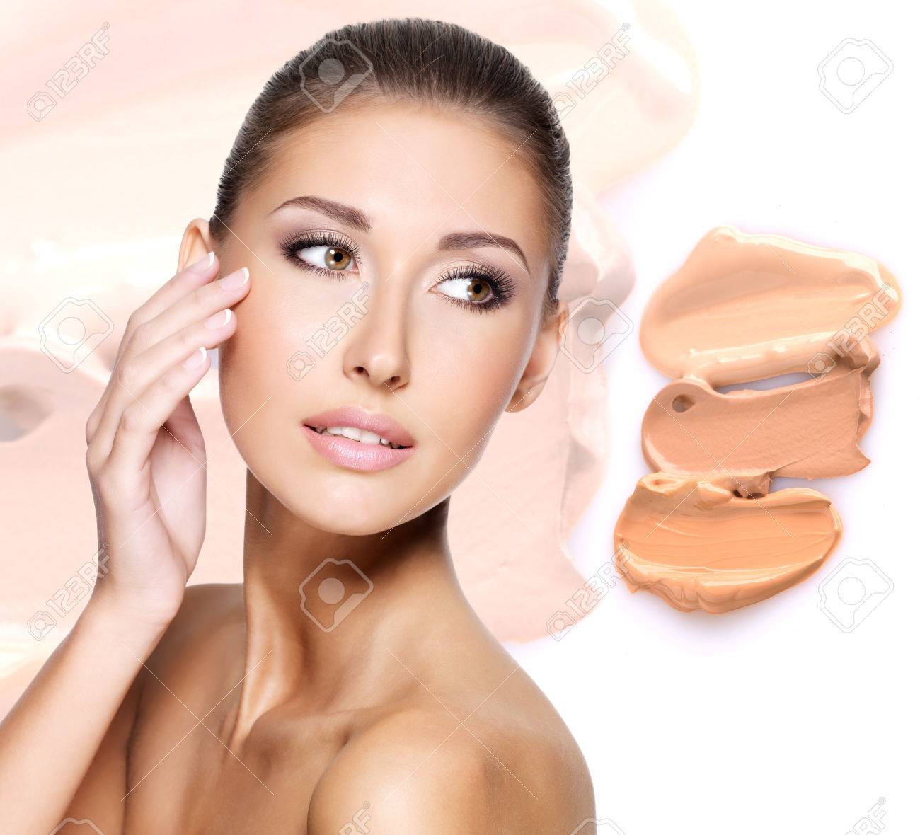 Model face of beautiful woman with foundation on skin make-up cosmetics . Stock Photo - 23271812