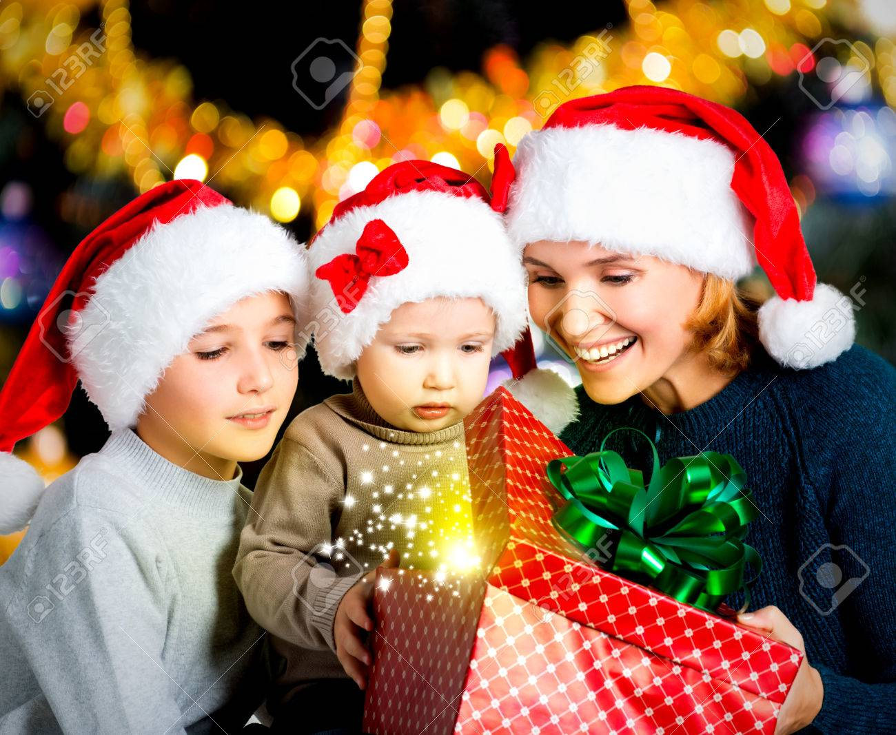 Mother With Happy Children Opens The Box With Christmas Gifts ...