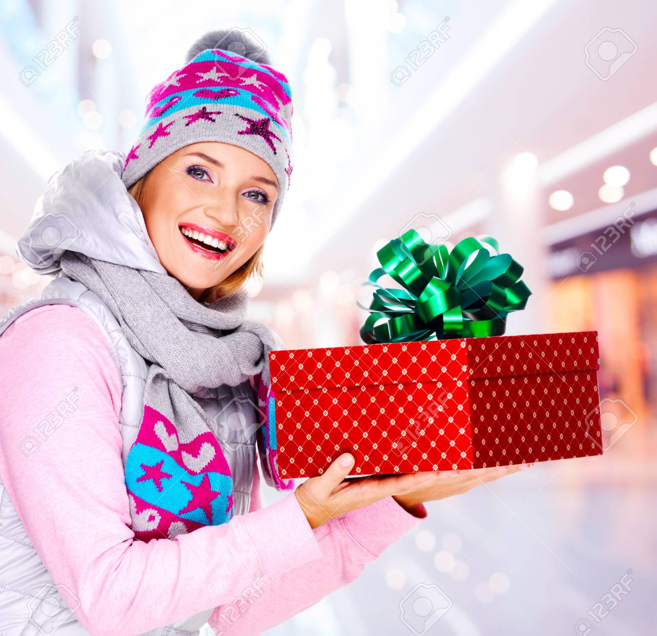 Photo Of Young Adult Woman Gives The Christmas Gift Dressed.. Stock ...