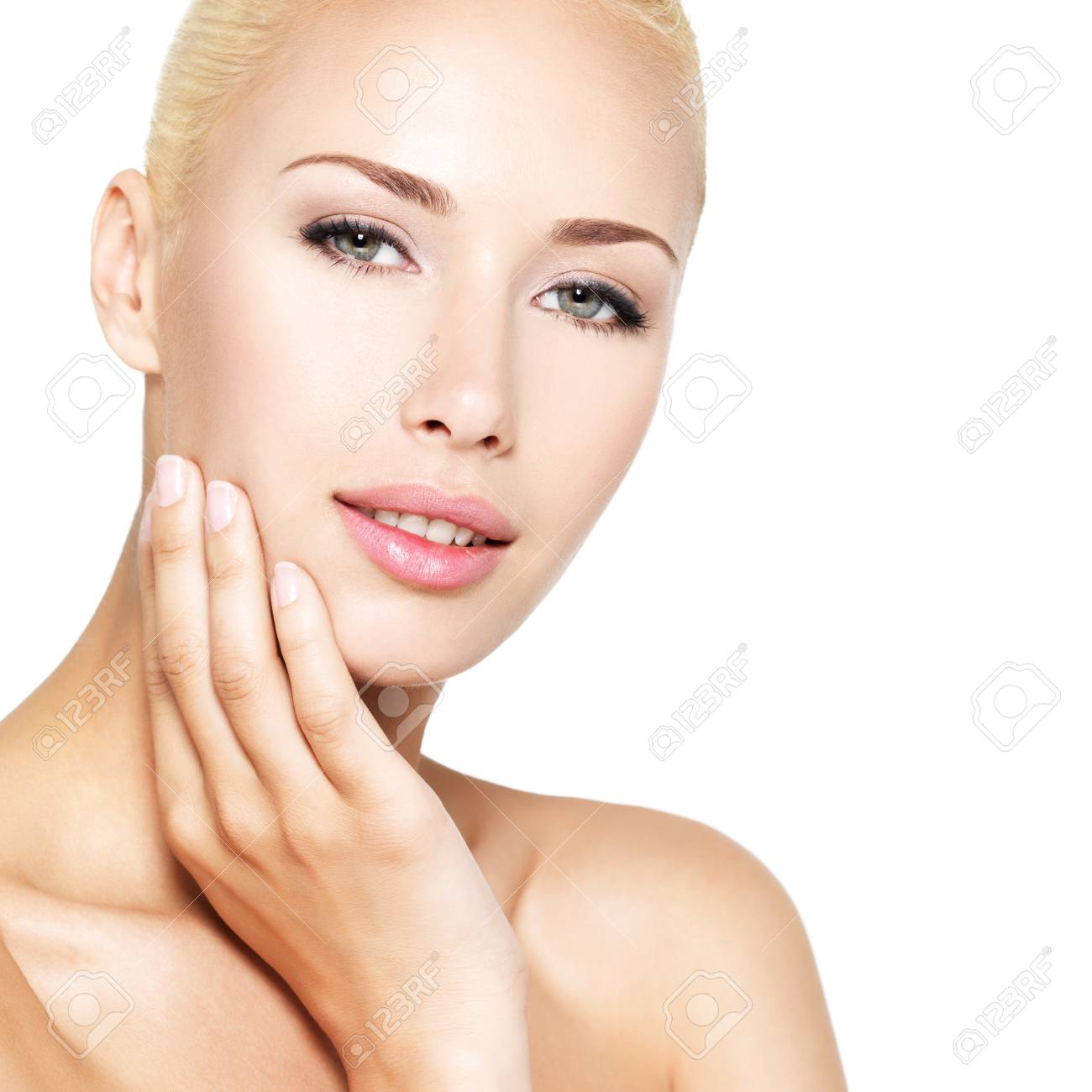 Beauty face of the young pretty blond woman with hands - isolated on white Stock Photo - 24246435