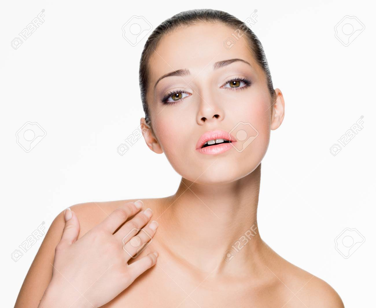 Closeup portrait of beautiful woman with fresh skin of face - isolated on white Stock Photo - 24246430