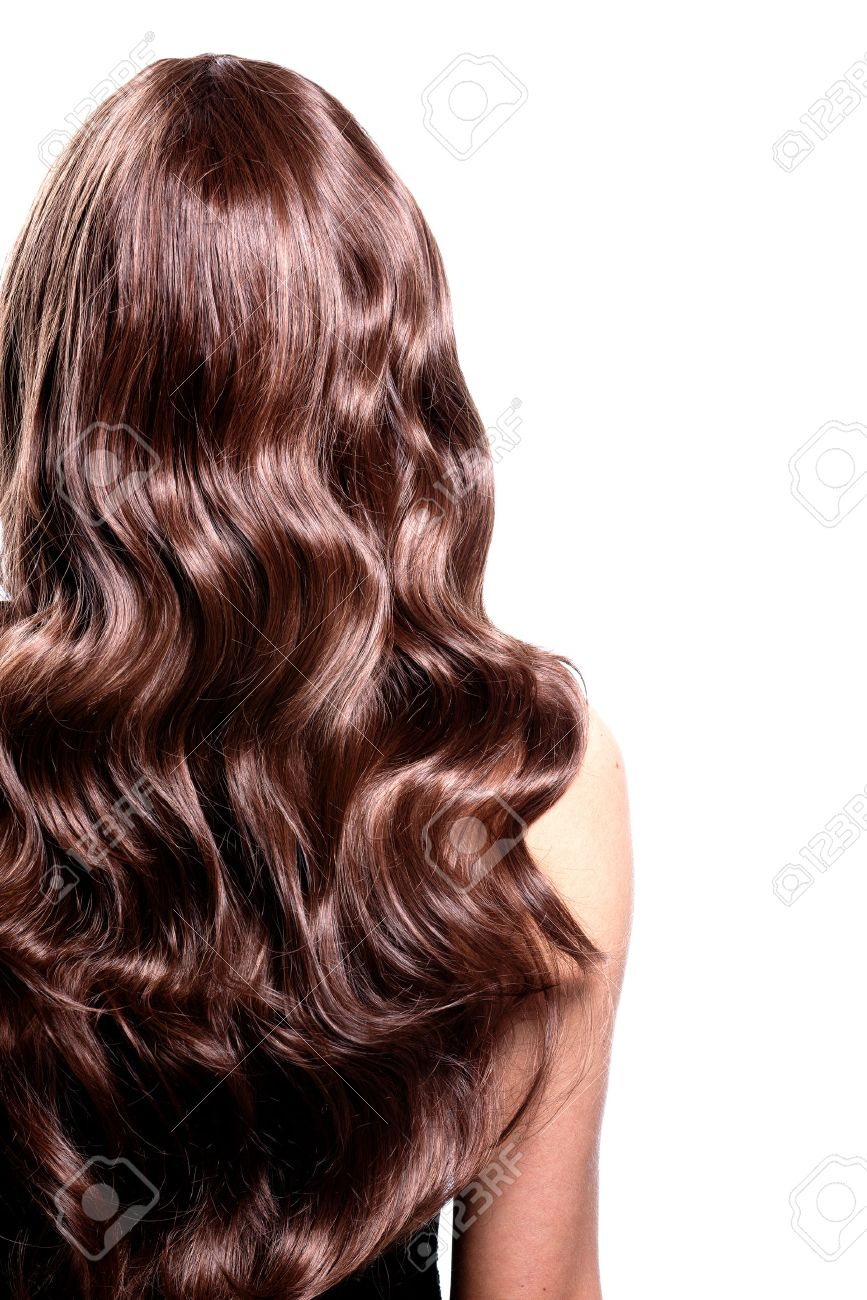 Back View Of Brunette Woman With Long Black Curly Hair Posing
