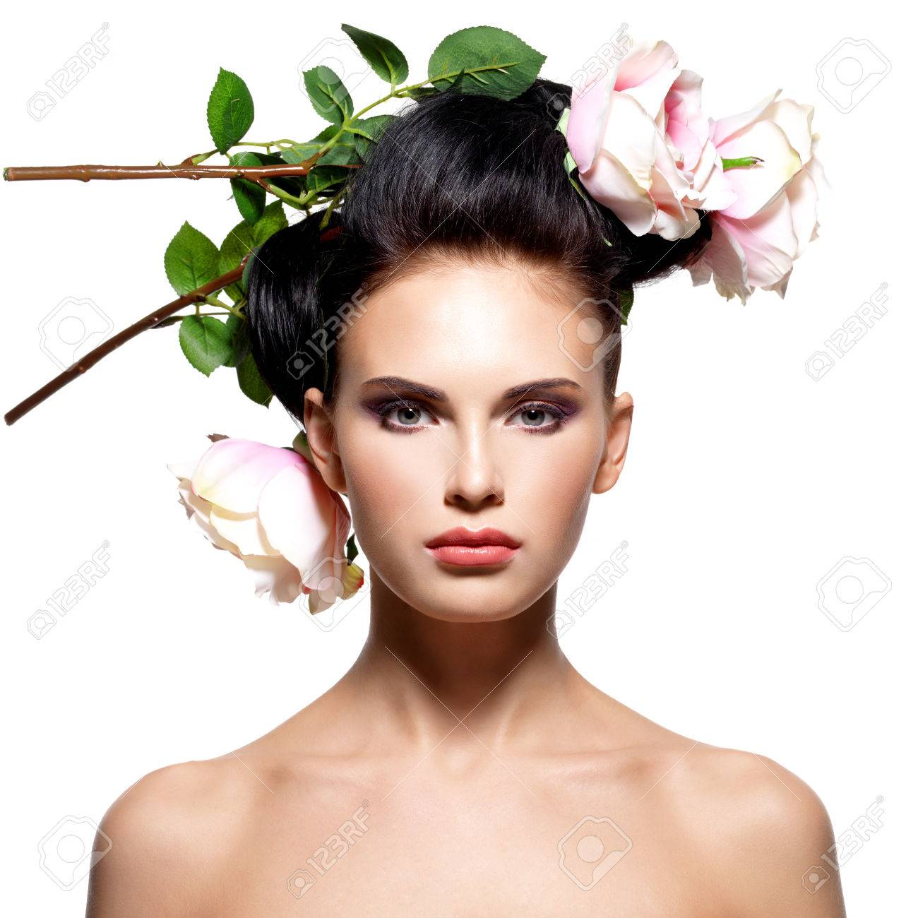 Beautiful Young Woman With Pink Flowers In Hair Isolated On