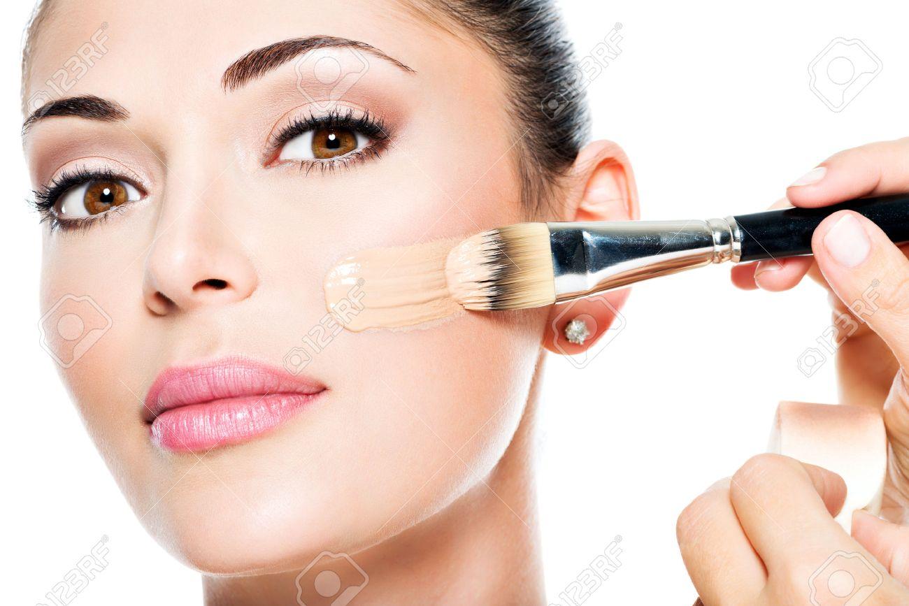 Makeup Artist Applying Liquid Tonal Foundation On The Face Of The Woman  Stock Photo 34478513 Makeup