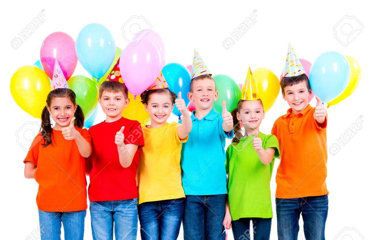 Group Of Happy Children In Colored T Shirts And Party Hats With Balloons Showing Thumbs