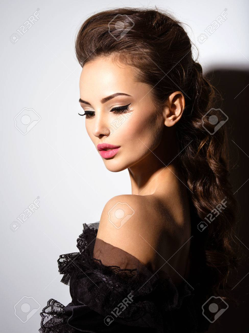 29456ac51 Beautiful Face Of An Young Sexy Woman In Black Dress Posing.. Stock ...