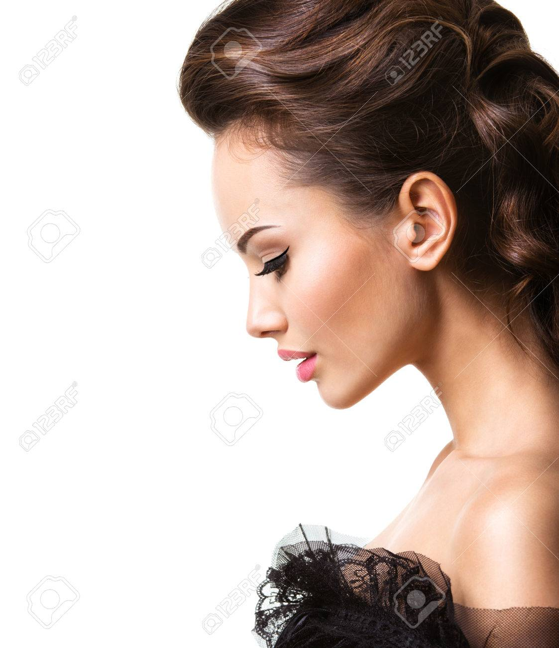 33a7f23ee Beautiful Face Of An Young Sexy Woman In Black Dress Posing At ...