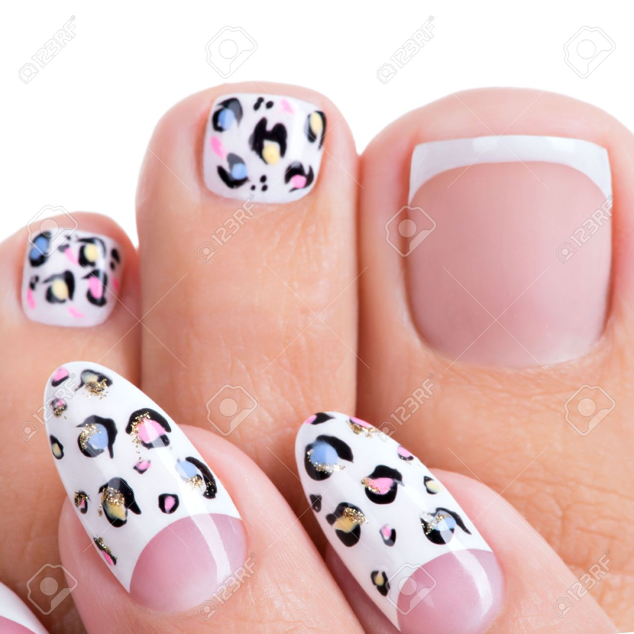 Beautiful womans nails of hands and legs with beautiful french beautiful womans nails of hands and legs with beautiful french manicure pedicure with art design prinsesfo Choice Image
