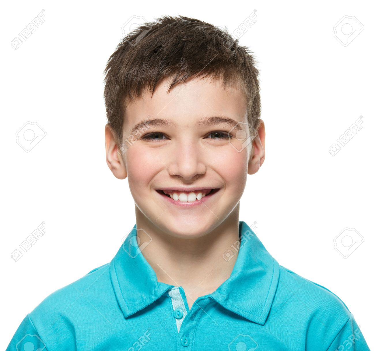 Portrait of young happy teen boy looking at camera. - 53555185