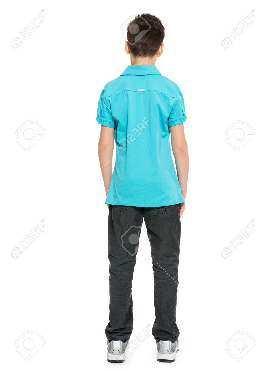 Full portrait of teen boy standing back in casuals - isolated on white background - 53555194