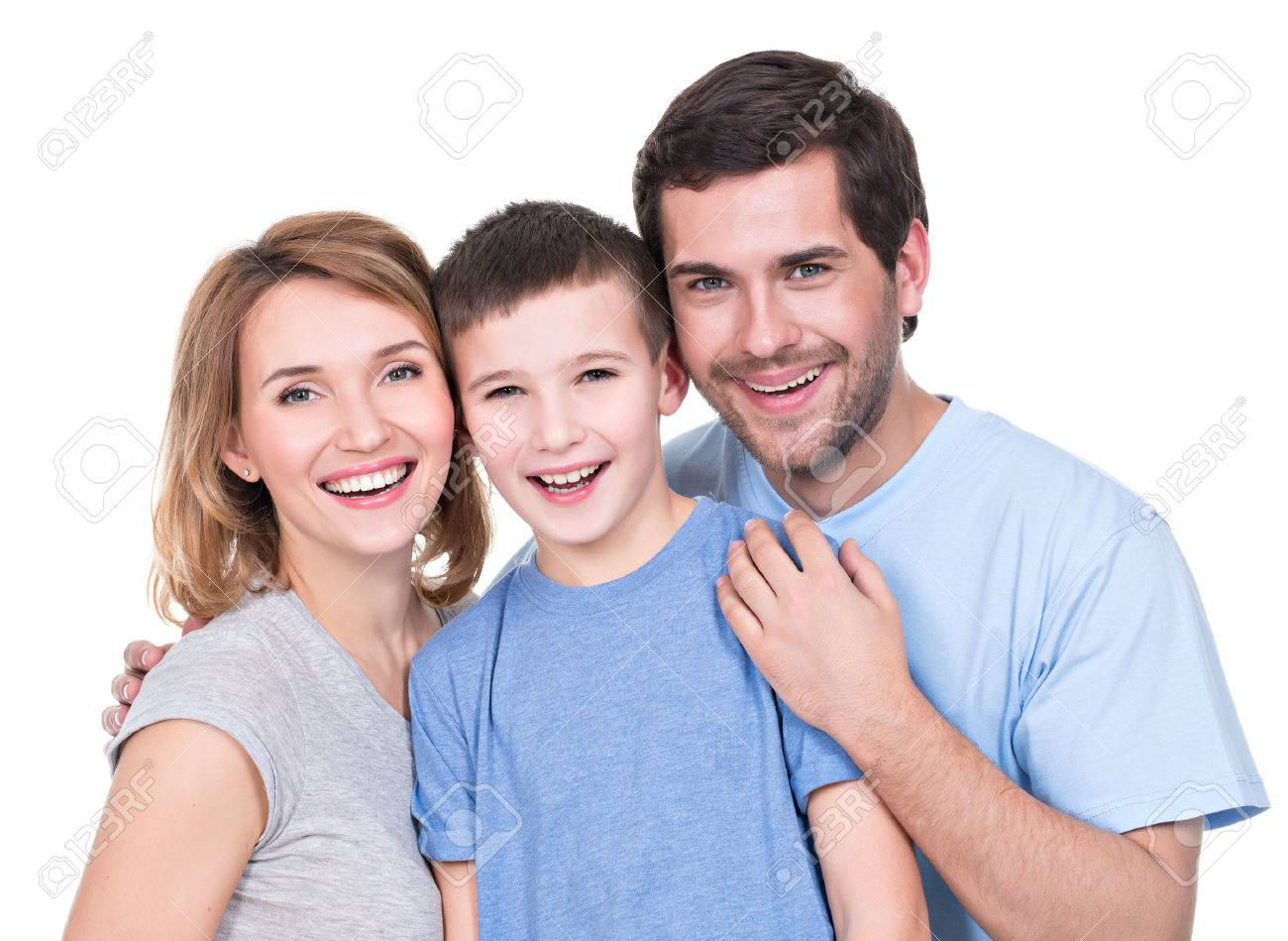 Portrait of the happy parents with son looking at camera - isolated on white background - 53555524