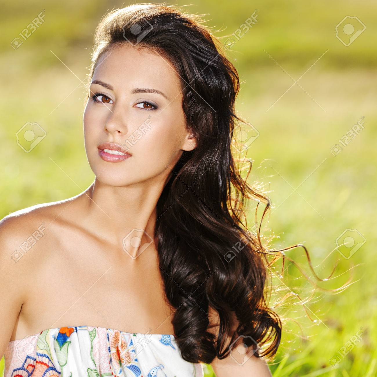 Portrait of an young beautiful sexy woman on the nature Stock Photo - 53558588